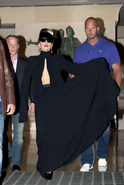 Lady Gaga went for some goth drama in a pleated black maxi dress with extra-long sleeves and a bodice cutout while out in Paris.