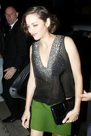 Marion Cotillard arrived for the 'Dark Knight Rises' after-party clutching a black Miss Dior bag.