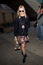 Kate Bosworth traveled light, carrying only a leopard-print tote along with a mini shoulder bag.
