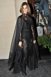 Carine Roitfeld sealed off her sultry look with a pair of knee-high black lace-up boots.