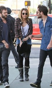 Miley Cyrus accessorized with a black leather shoulder bag by Tylie Malibu while grabbing sushi.