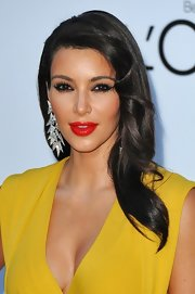 Kim Kardashian accessorized with a massive pair of geometric chandelier earrings.