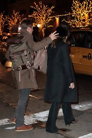 Ryan Gosling slung a utilitarian canvas and leather backpack on his shoulder as he spent New Year's Eve with Eva Mendes.