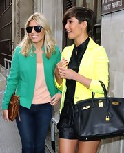 Mollie King kept her eyes hidden behind a pair of Persol shades as she left the BBC Radio studios.
