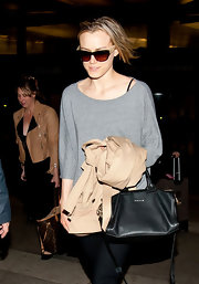 Taylor Schilling hid her eyes behind a pair of two-tone sunnies while making her way through LAX.