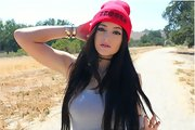 Kylie Jenner brightened up her raven tresses with a fuchsia beanie for this social media pic.