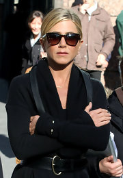 Jennifer Aniston kept the sun out with a pair of brown wayfarers while filming 'Wanderlust.'