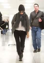 Rooney Mara teamed black moto boots with jeans and a cardigan for her edgy airport look.