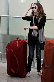 Anna Kendrick was spotted at the airport standing beside a massive red rollerboard.