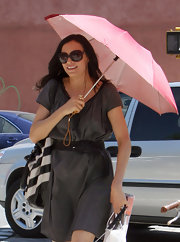 Famke Janssen found her cute folding umbrella useful during a hot sunny day in NYC.