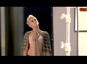 Miley Cyrus donned a nude bra under an embellished cape for a video shoot.