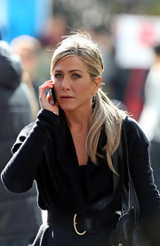 Jennifer Aniston kept her wraparound cardigan in place with a black leather belt while filming 'Wanderlust.'