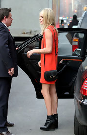 Kate Bosworth went shopping in Soho carrying a Derek Lam Ram's Head Buffalo Leather mini bag.
