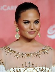 Chrissy Teigen jazzed up her simple 'do with a pair of oversized dangling gemstone earrings.