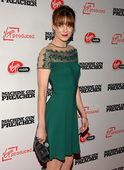Michelle Monaghan paired a black frame clutch by Judith Leiber with a green cocktail dress for the premiere of 'Machine Gun Preacher.'