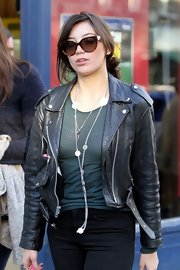 Daisy Lowe took a stroll wearing a pair of cateye sunnies.