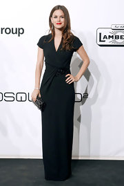 Rachel Bilson finished off her elegant ensemble with a crystal-embellished black clutch, also by Ferragamo.