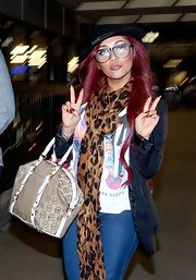 Nicole Polizzi caught a flight at LAX carrying a beige and white Michael Kors tote.