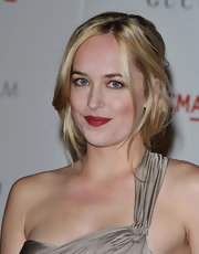 Dakota Johnson swiped on some red lipstick for an extra dose of sexiness.