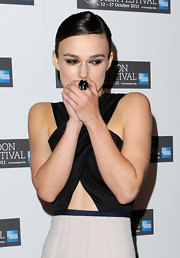 Keira Knightley attended the premiere of 'A Dangerous Method' wearing a black Chanel Camellia ring.