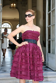 Clotilde Courau paired her frock with a broad black belt.