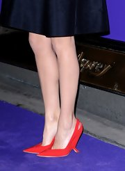 Marion Cotillard chose fiery red Dior slingbacks with an unusual heel for the EE British Academy Film Awards Nominees Party.