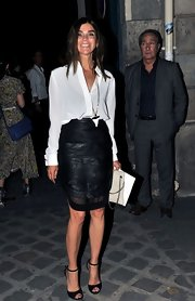 Carine Roitfeld kept it classic in a white button-down teamed with a black leather pencil skirt during the Givenchy fashion show.