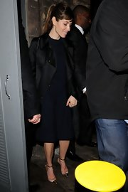 Jessica Biel left the Brit Awards looking chic in gold Manolo Blahnik cap-toe pumps and a black coat.