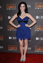 Demi Lovato styled her dress with silver peep-toes by Rene Caovilla.