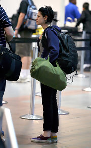 Kristen Stewart caught a flight out of LAX carrying a green duffel bag.