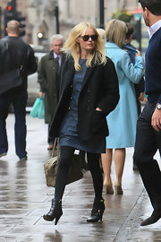 Kate Bosworth was spotted leaving the Covent Garden Hotel wearing a baggy black wool coat over a denim dress.