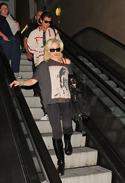 Gwen Stefani arrived on a flight at LAX looking edgy in a loose shirt, leggings, and knee-high boots.