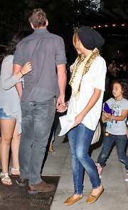 Miley Cyrus went for a simple and casual white tee when she stepped out with boyfriend Liam Hemsworth.