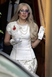 Lady Gaga completed her eye-catching ensemble with white leather gloves.