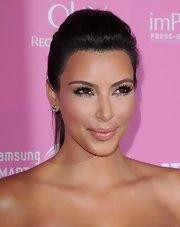 Kim Kardashian looked chic and trendy wearing this teased ponytail during the Us Weekly Hot Hollywood event.