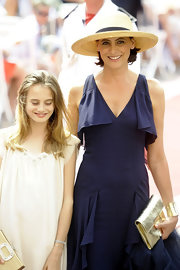 Ines de la Fressange completed her look with a gold leather clutch at the Monaco royal wedding.