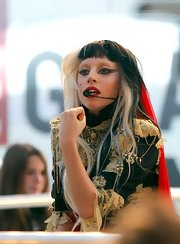 Lady Gaga sported exaggeratedly winged eyes while performing on 'Grand Journal.'