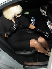 Lady Gaga put on her signature black leather gloves for a night out.