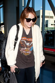 Miley Cyrus made her way through LAX wearing a pair of square shades by Grey Ant.