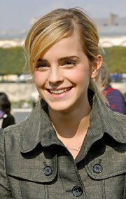 Emma Watson pulled her locks back into a messy ponytail with side-swept bangs for the Dior fashion show.