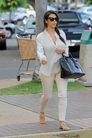 Kim Kardashian made her way to Kanye's recording studio wearing a breezy white button-down.
