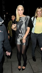 Gwen Stefani enjoyed a night out in London wearing an iridescent mini dress.