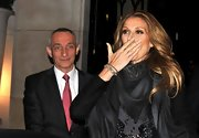 Celine Dion kept warm with a patterned black scarf while out in Paris.