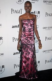 Alek Wek looked ultra girly in a strapless black lace gown with a pink underlay during the amfAR Inspiration Gala.