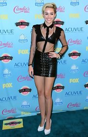 Miley Cyrus punctuated her black outfit with pointy white platform pumps by Saint Laurent.