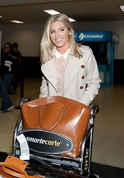 Mollie King arrived on a flight at LAX carrying an oversized camel-colored tote by Zara.