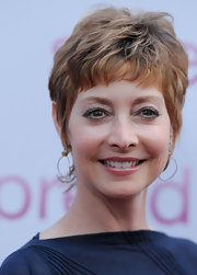 Sharon Lawrence wore her hair in a tousled razor cut at the premiere of 'Spread.'
