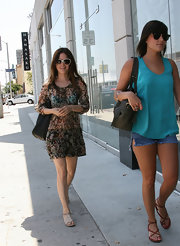 Rachel Bilson chose flat nude sandals to complete her breezy look.