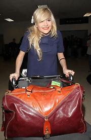 Pixie Lott arrived at LAX with a full-packed red and orange Dolce & Gabbana duffle bag.