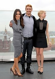 Mila Kunis sheathed her figure in a ruched and ruffled gray dress by Givenchy for the 'Oz the Great and Powerful' photocall in Moscow.